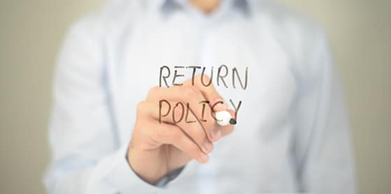 stock-photo-return-policy-man-writing-on-transparent-screen-701903608